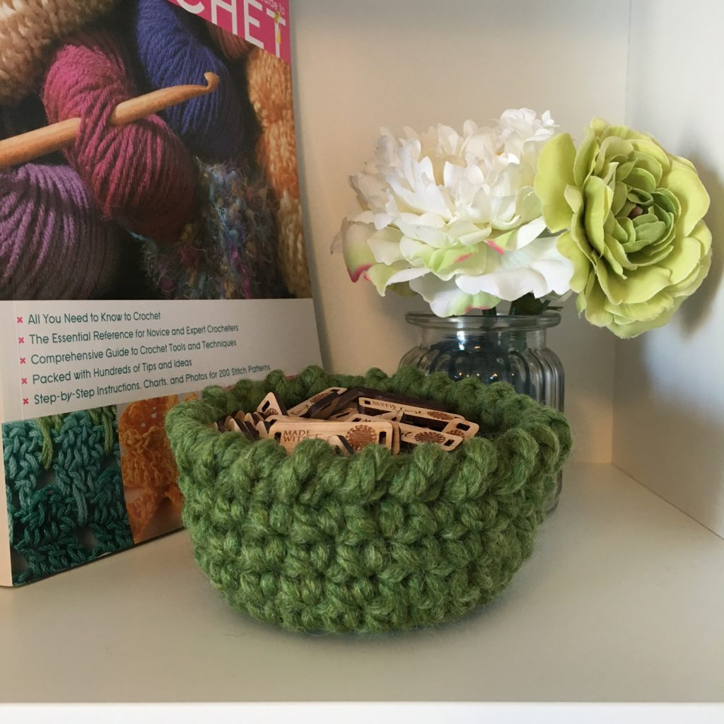 Photo of the FREE Universal Bowl Crochet Pattern with a small vase of flowers
