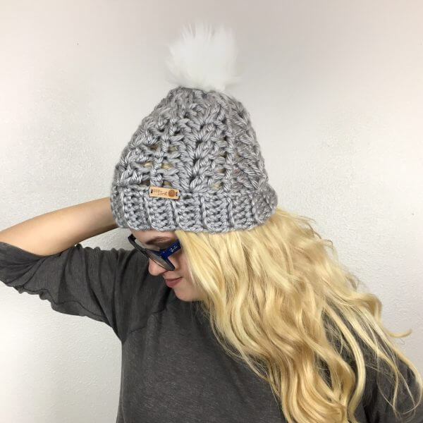 A lovely woman enjoying her McKenna Pompom Beanie