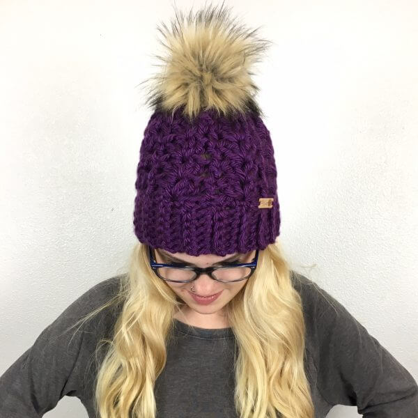 A woman wearing the McKenna Pompom Beanie Crochet Pattern