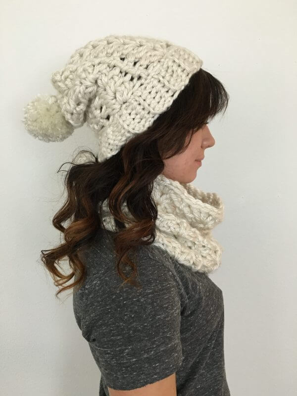 A woman wearing the crocheted McKenna Beanie with white background