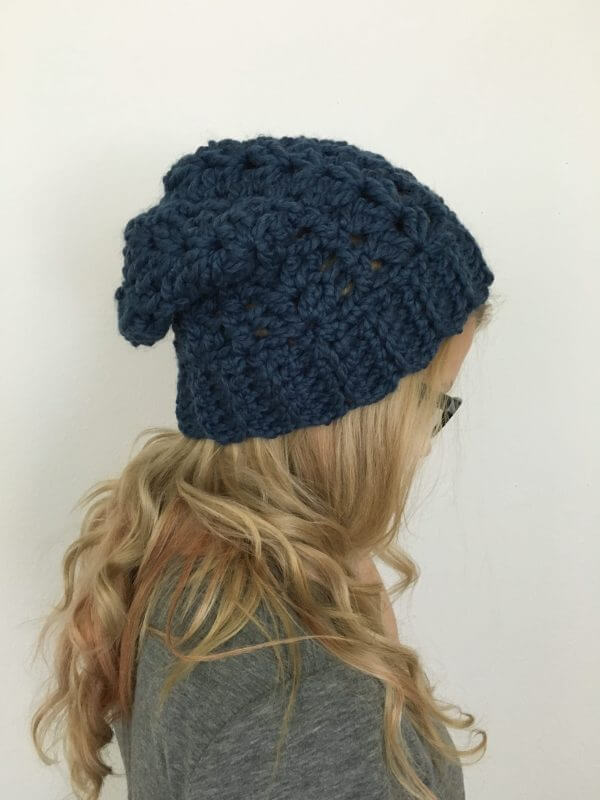 A blonde woman wearing the crocheted McKenna Beanie