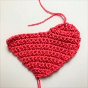 Instructional photo of making the Conversation Pillow Hearts FREE Crochet Pattern
