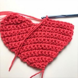 Instructional photo of making the crocheted Valentine's Conversation Pillow Hearts