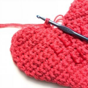 Photo of finishing the crocheted Valentine's Day Conversation Pillow Hearts
