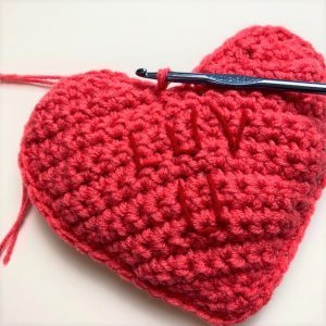 Photo of finishing the Valentine's Day Conversation Pillow Hearts FREE Crochet Pattern