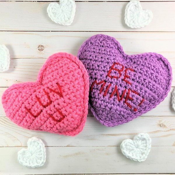 photo of two crocheted conversation heart pillows