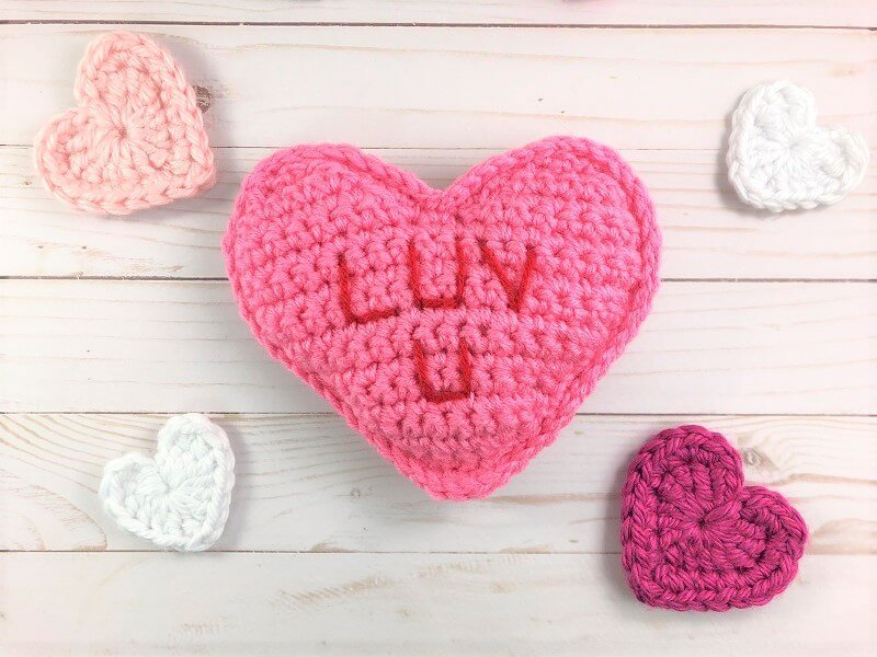 "Photo of the Pink Conversation ""Luv U"" Hearts with small crocheted heart-shaped coasters"