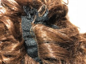 Instruction image for cutting the faux hair for the Phoneytail Hat