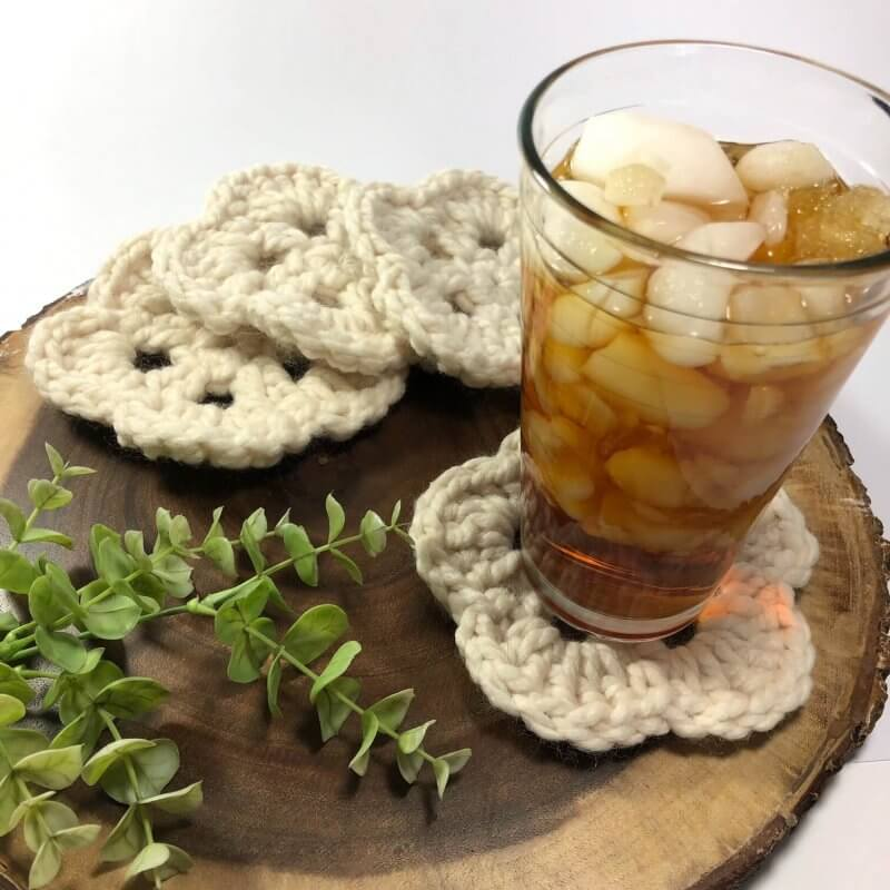 Photo of a cold iced tea on top of the crocheted Springtime Coasters