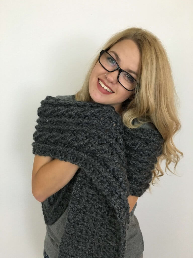 Woman enjoying the Ardara Oversized Cable Scarf