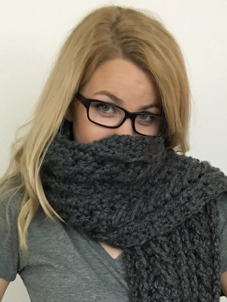 Close up photo of a woman wearing the Ardara Oversized Scarf FREE Crochet Pattern