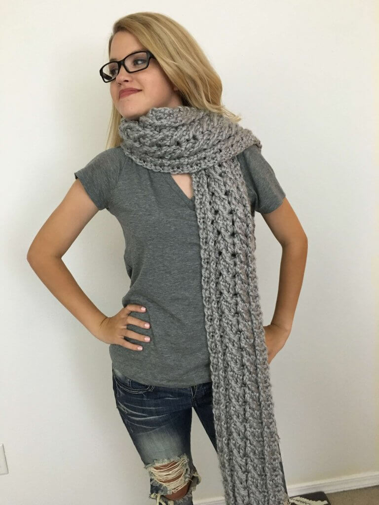 Woman wearing the Ardara Oversized Cable Scarf FREE Crochet Pattern