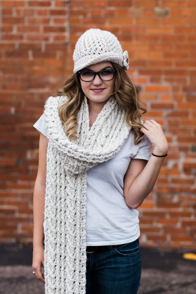 Photo of a woman wearing the Ardara Oversized Scarf paired with a crocheted hat