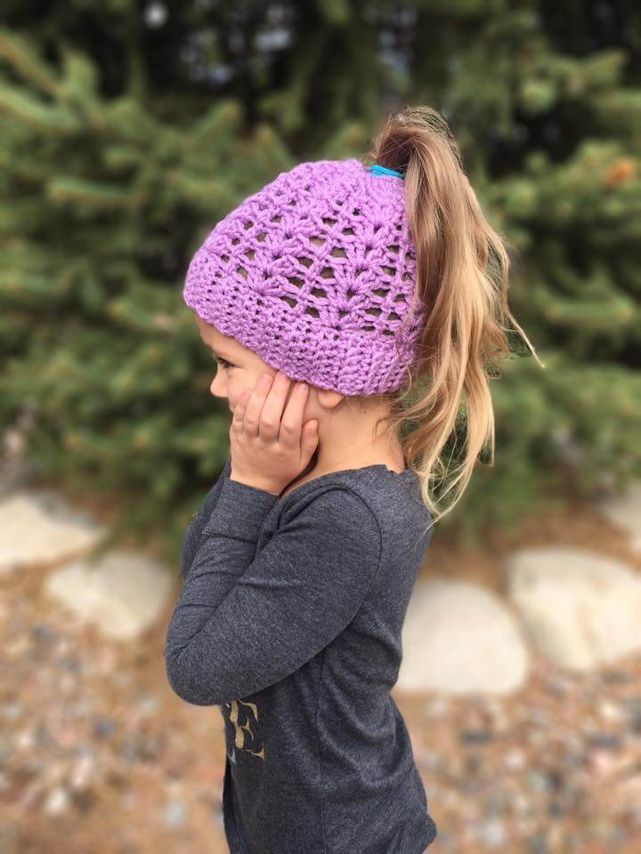 Photo of a little girl wearing the crocheted Lily Ponytail Hat