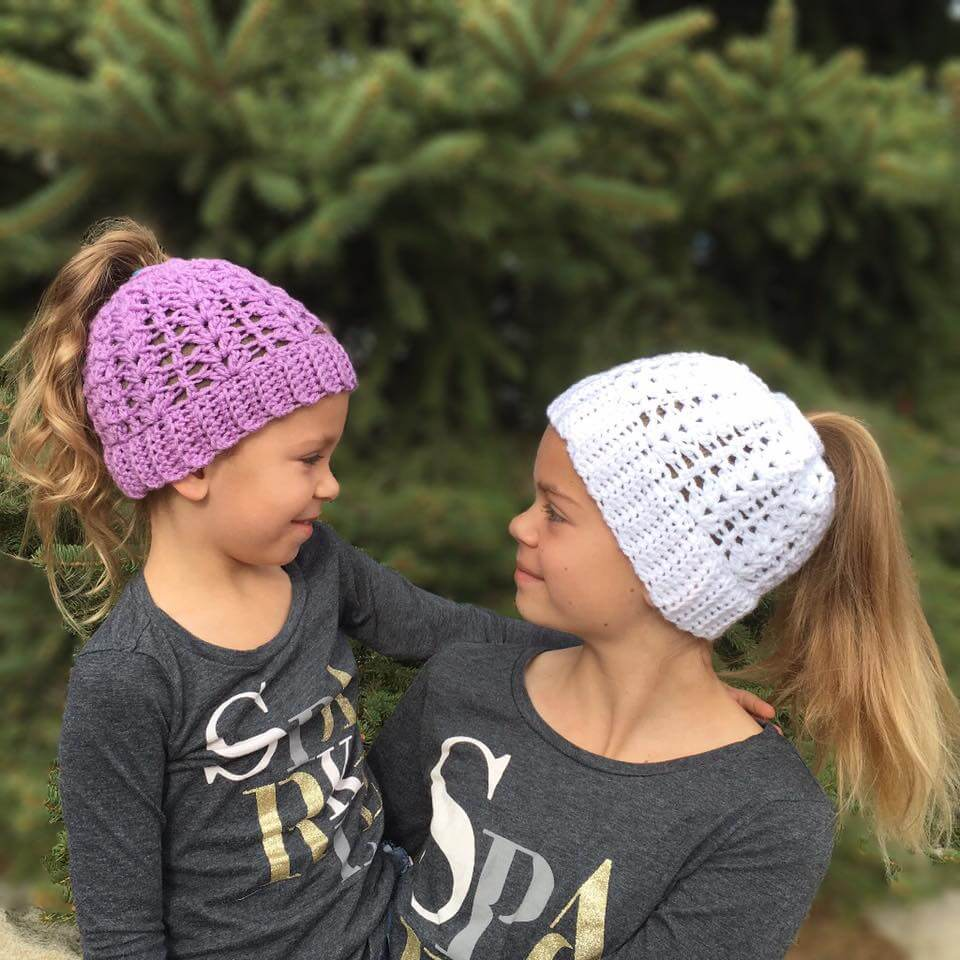 Photo of 2 young girls wearing Lily Ponytail Hat Free Crochet Pattern
