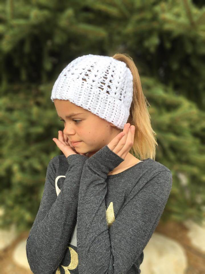 Photo of a little girl wearing the Lily Ponytail Hat FREE Crochet Pattern