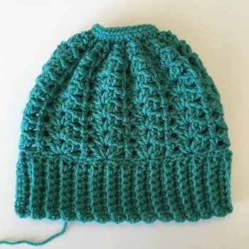 Completed crocheted Lily Ponytail Hat