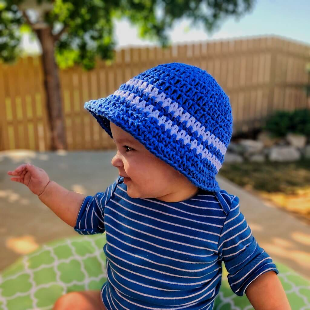 Photo of a cute baby wearing the Sun & Sand Bucket Hat for Kids