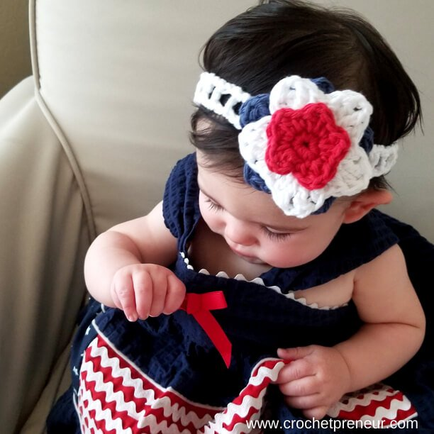 Image of a baby wearing the Stars & Stripes Headband FREE Crochet Pattern