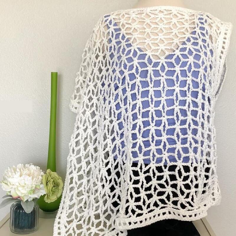 Photo of the asymmetrical Star-Strangled Poncho crochet pattern
