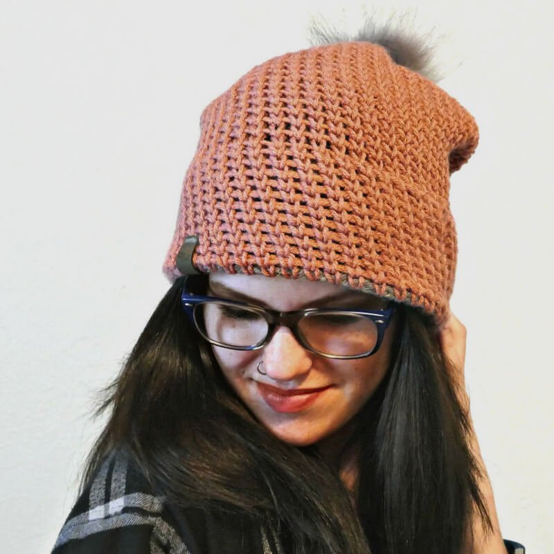 Photo of the finish crochet slouchy hat worn by a woman