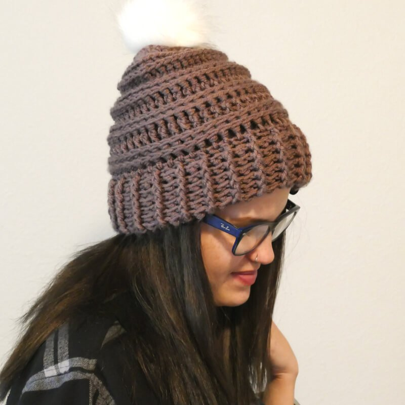 Photo of a woman wearing the crocheted Keystone Ribbed Hat