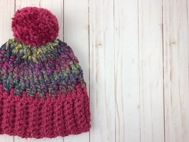 Photo of crocheted Denali Peaks Unisex WInter Hat on a wooden planks