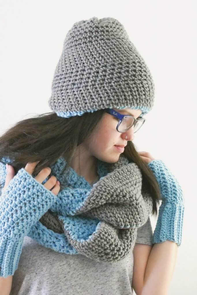 Image of a woman wearing the crochet Polly Hat, Infinity Scarf, and Fingerless gloves.