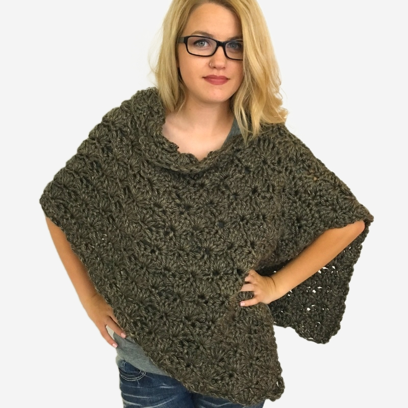 Photo of a blonde woman wearing the easiest crochet poncho ever