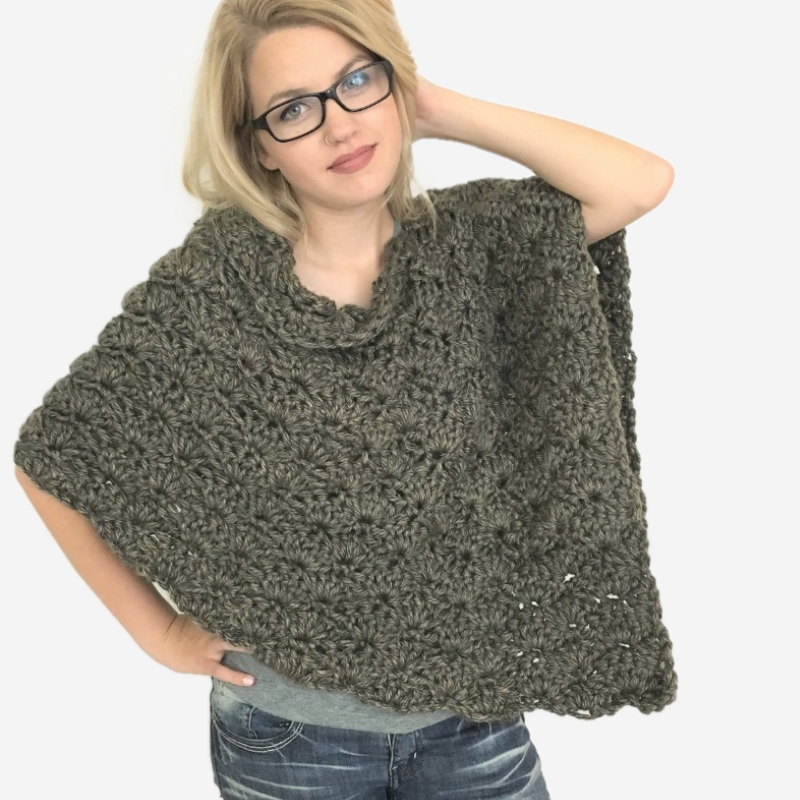 Photo of blonde woman wearing Lion Brand Hometown USA Little Rock Granite poncho