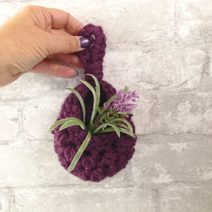 square image of a hanging teardrop basket made from Lion Brand Wool Ease Thick and Quick in the Fig colorway