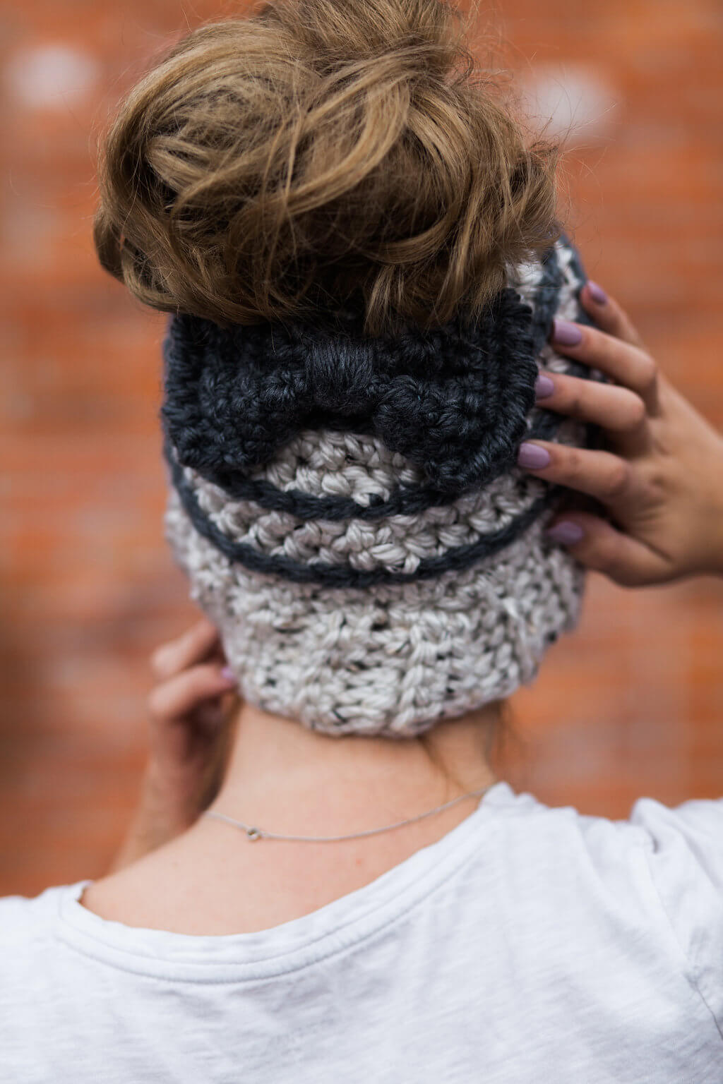 Back view of the Striped Beehive Messy Bun Hat with a Bow