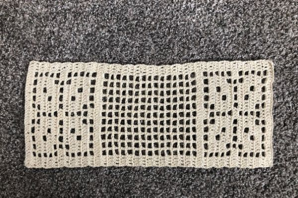 Image of an unblocked autumn leaves filet crochet table runner