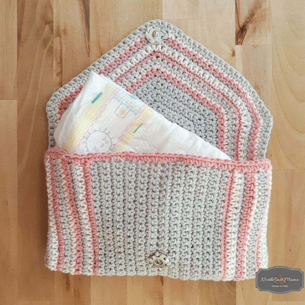 Chic crochet clutch with a baby diaper inside.