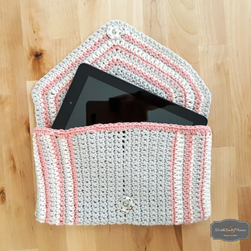 Sample image of crochet clutch with a tablet inside.