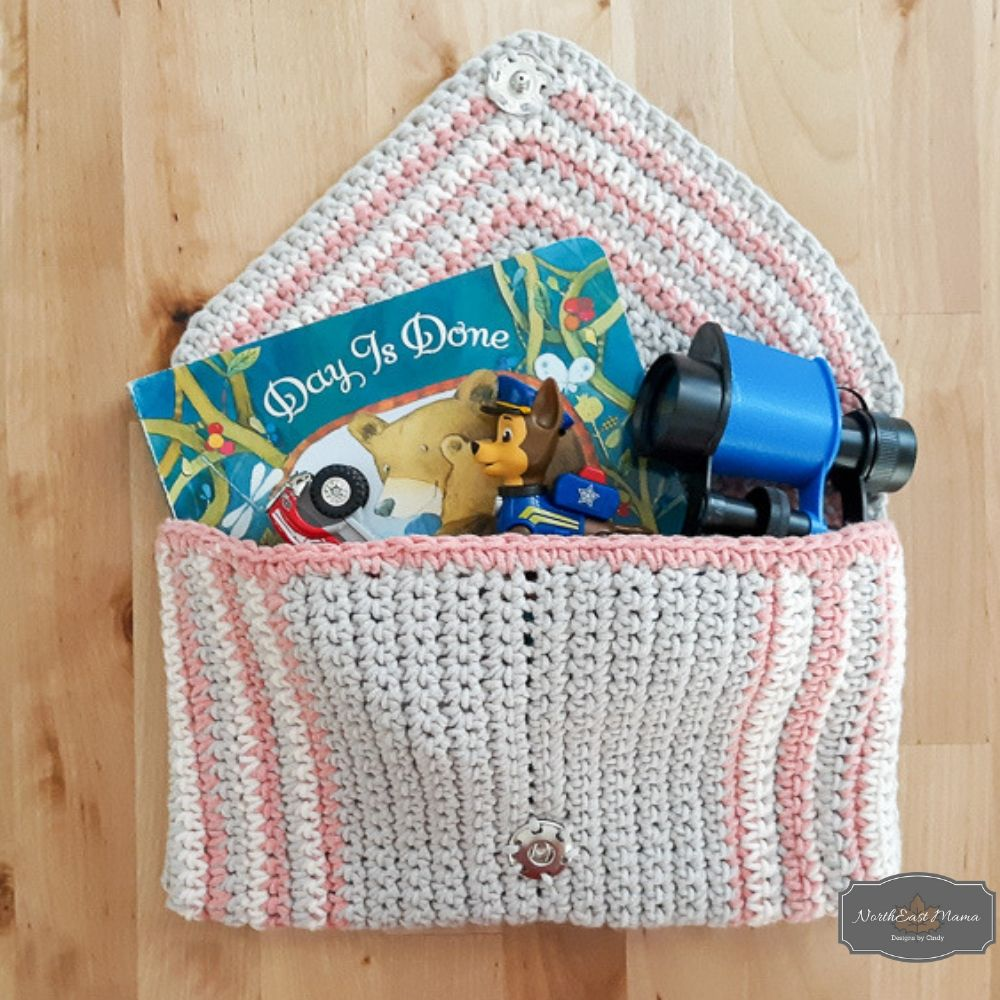Chic crochet clutch with kids' toys inside.