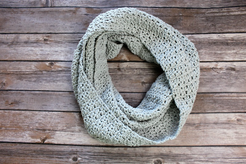 Photo of the FREE Friendship Cowl Crochet Pattern on a wooden table