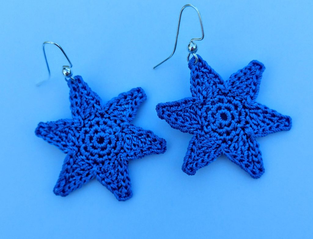 Close up image of the 1st Bliss This Drop Star Earring design FREE Crochet Pattern