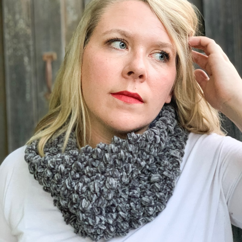 Photo of a blonde woman wearing the crocheted soft Velvet Puff Cowl