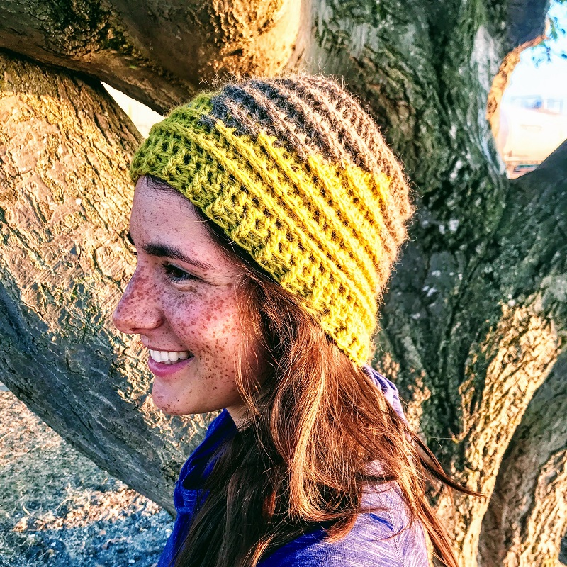 Photo of a woman enjoying the outdoors wearing the crocheted hat