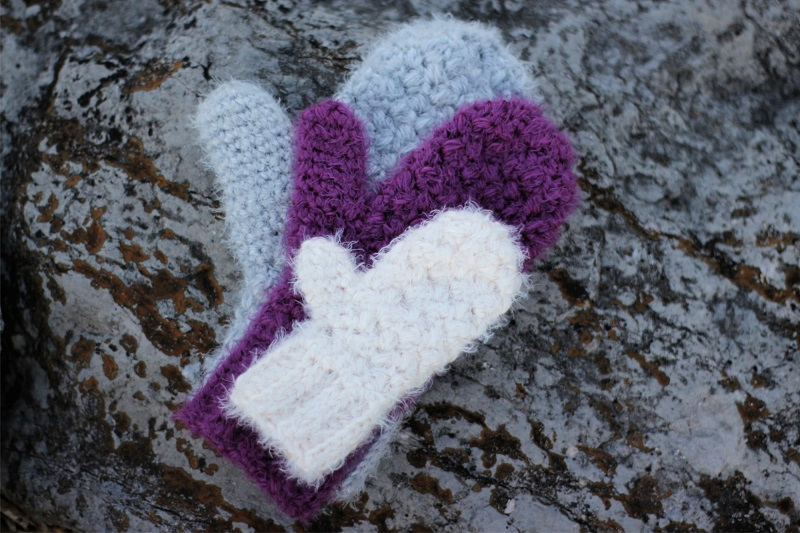 Photo of crochet hygge mittens in various sizes and colors