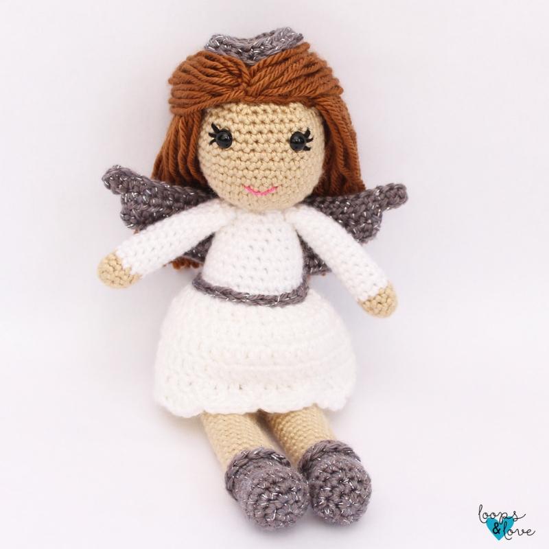 Photo of a sitting  crocheted amigurumi angel