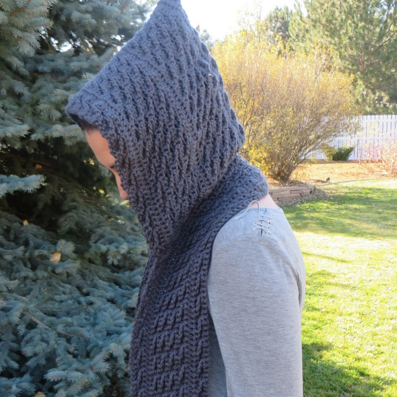A woman wearing the hooded scarf