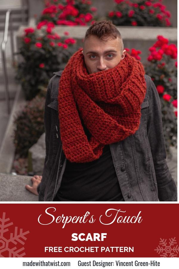 A Pinterest image for the Serpent's Touch infinity scarf. A rust colored, unisex scarf wrapped around the neck of a man who is looking at the camera and surrounded by red flowers.