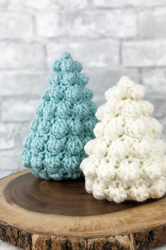 Photo of 2 Bobble Christmas Trees in blue and white colors on a flat wooded decor
