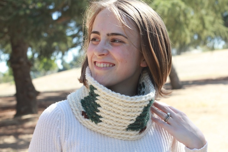 Photo of Claire wearing the crocheted Pinewood Tapestry Cowl outdoors