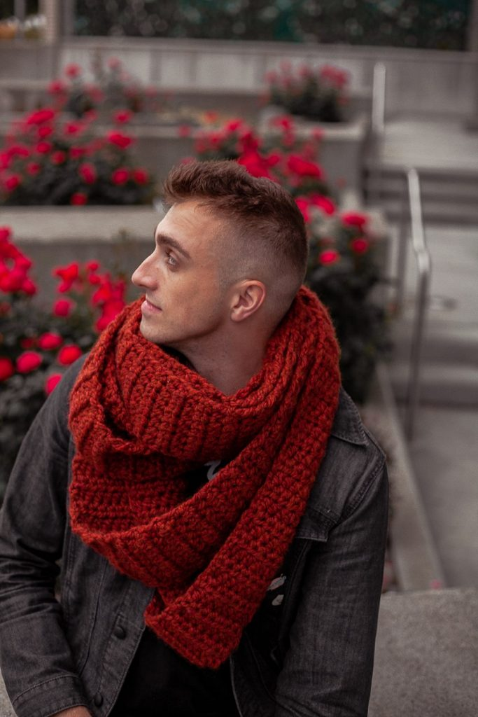 Photo of Vincent Green-Hite wearing the Serpent's Touch Unisex Infinity Scarf looking away from the camera