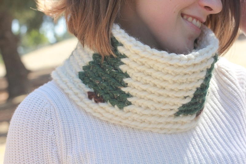 Closer photo of the crocheted cowl worn by Claire outdoors with a white long-sleeved shirt