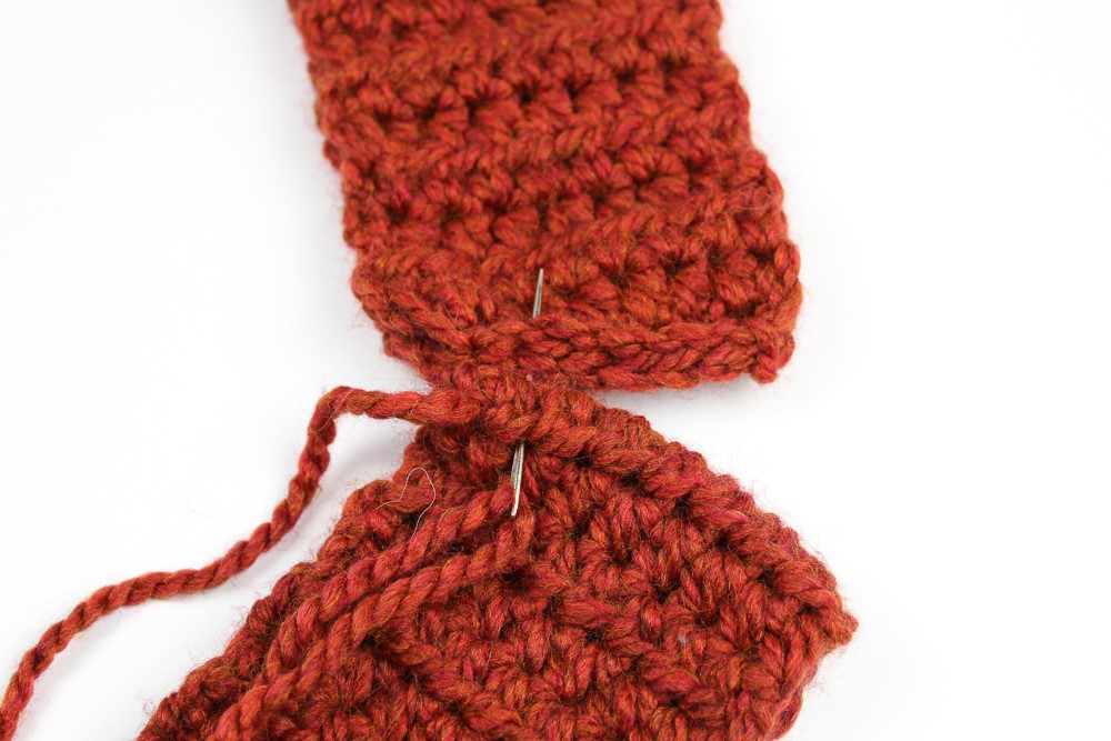 Tutorial photo of sewing both ends of the scarf together to make an infinity scarf