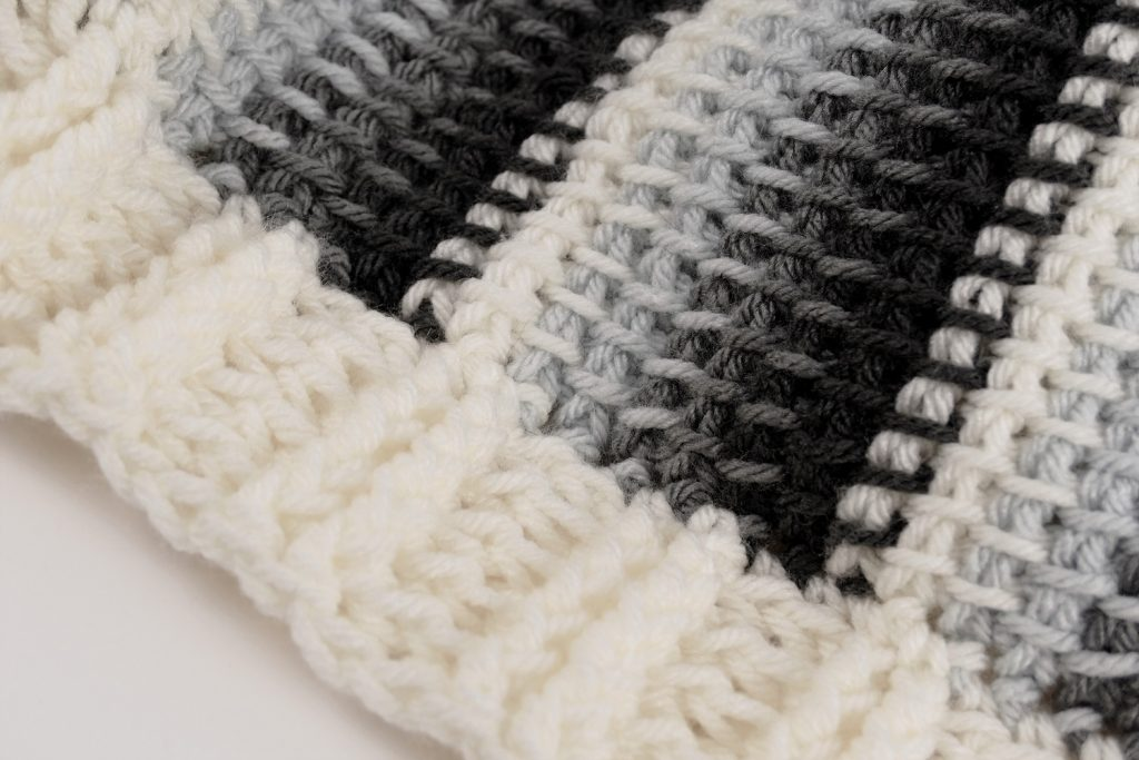 Close look at the stitches and the border of this crocheted Tunisian Baby Blanket